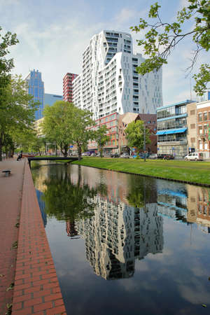 ROTTERDAM, NETHERLANDS - MAY 31, 2019: Modern buildings reflected on Westersingel canal along Mauritsweg street (near Kruisplein)