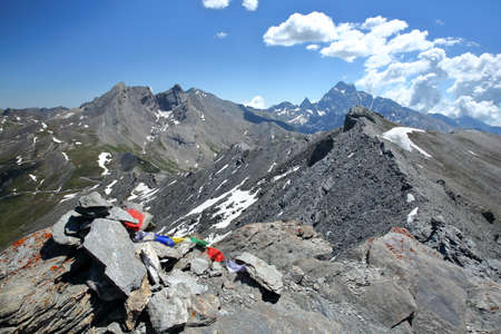 A mountain ridge viewed from Caramantran Peak (above Agnel pass), with mount Viso in the background, Queyras Regional Natural Park, Southern Alps