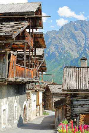 Close-up on traditional houses with traditional wooden balconies in Saint Veran village, Queyras Regional Natural Park, Southern Alps, France