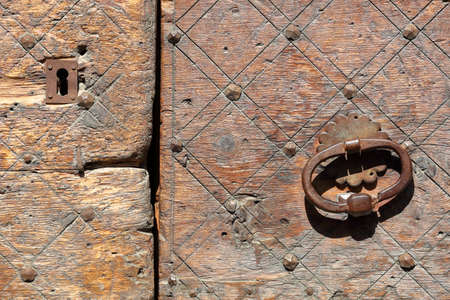 Close-up on a traditional wooden door in Saint Veran village, Queyras Regional Natural Park, Southern Alps, France