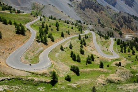 The Southern side of Izoard pass with the winding road (famous for cyclists), Queyras Regional Natural Park, Southern Alps, France, Europe, hautes alpes Stock fotó