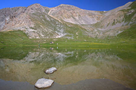Souliers lake located above Izoard Pass (after one hour hike from Casse deserte car park), with reflections of mountain range, Queyras Regional Natural Park, Southern Alps, France Stock fotó