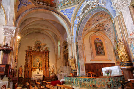 ABRIES, QUEYRAS, FRANCE - JUNE 29, 2019: The colorful interior of Saint Pierre (and Saint Antoine) church, decorated with frescoes and located in Abries village, Queyras Regional Natural Park, Southern Alps