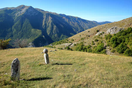 Tombstones overlooking Rakitnica canyon and located along a hiking trail leading to Lukomir village, Bosnia's highest village at 1469 meters and the most remote in the entire country, Bosnia and Herzegovina Stock Photo