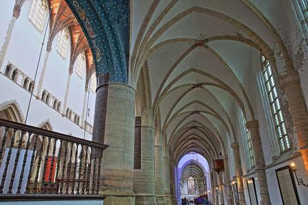 HAARLEM, NETHERLANDS - NOVEMBER 29, 2019: The interior of St Bavokerk Church, with  an alignement of columns and arches Editorial