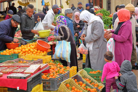 TOZEUR, TUNISIA - DECEMBER 21, 2019: The lively and colorful fruit and vegetable market with locals