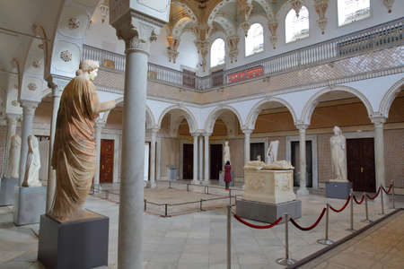 TUNIS, TUNISIA - DECEMBER 08, 2019: The Carthage room inside the Bardo Museum with roman sculptures, arcades, columns and mosaics