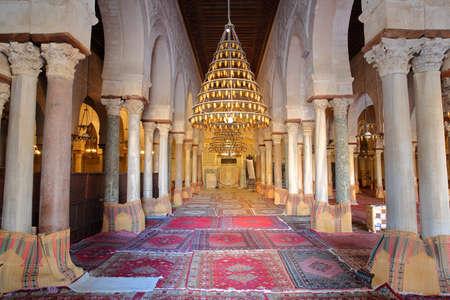 KAIROUAN, TUNISIA - DECEMBER 10, 2019: The prayer room of the Great Mosque of Kairouan Standard-Bild - 141072895