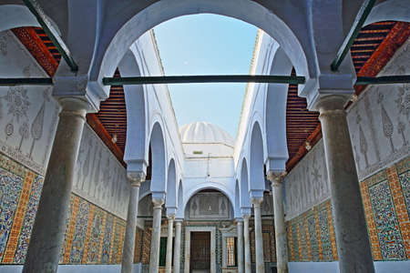 KAIROUAN, TUNISIA - DECEMBER 10, 2019: The Abou Zamaa Zaouia (Barber's mosque or Sidi Sahbi mosque), with colorful tiles, columns and arcades