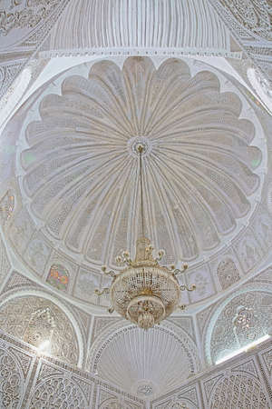 KAIROUAN, TUNISIA - DECEMBER 10, 2019: The Abou Zamaa Zaouia (Barber's mosque or Sidi Sahbi mosque), with an ornate ceiling with stucco mouldings Editorial