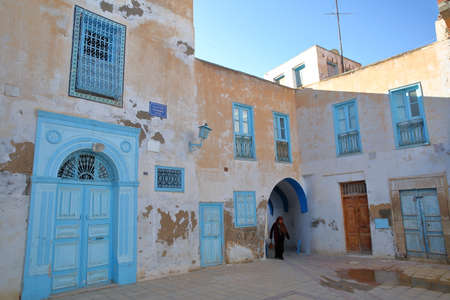 KAIROUAN, TUNISIA - DECEMBER 11, 2019: Typical colorful facades located at Bouras Square inside the historical medina of Kairouan