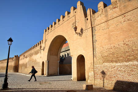 KAIROUAN, TUNISIA - DECEMBER 12, 2019: Entrance gate to Kairouan (eastern side of the city), with impressive and colorful ramparts