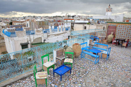 TUNIS, TUNISIA - DECEMBER 29 2019: Colorful tiled terraces overlooking the medina, with a panoramic view Editorial