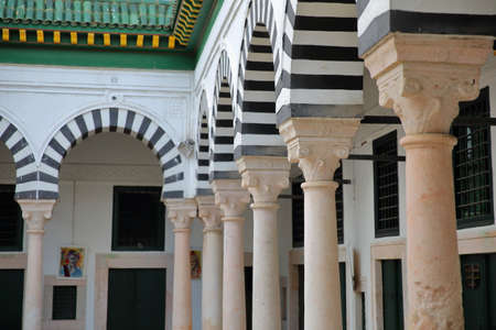 TUNIS, TUNISIA - DECEMBER 31, 2019: The inner courtyard of Slimania Medersa inside the medina, with a close-up on a row of columns Editorial