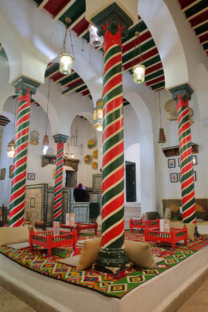 TUNIS, TUNISIA - JANUARY 01, 2020: The impressive colorful interior of El Mrabet Cafe, located inside the medina, with twisted columns and a high vaulted ceiling Editorial