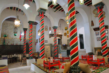 TUNIS, TUNISIA - JANUARY 01, 2020: The impressive colorful interior of El Mrabet Cafe, located inside the medina, with twisted columns and a high vaulted ceiling Standard-Bild - 141073443