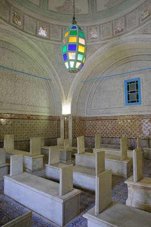 TUNIS, TUNISIA - JANUARY 01, 2020: The colorful interior of Tourbet el Bey Mausoleum, with tombs and stucco vaults