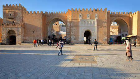 SFAX, TUNISIA - DECEMBER 22, 2019: Bab Diwan, the main entrance gate to the medina of Sfax, with impressive ramparts
