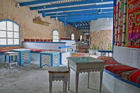 SFAX, TUNISIA - DECEMBER 23, 2019: The colorful interior of Diwan Cafe, a local cafe located inside the medina of Sfax