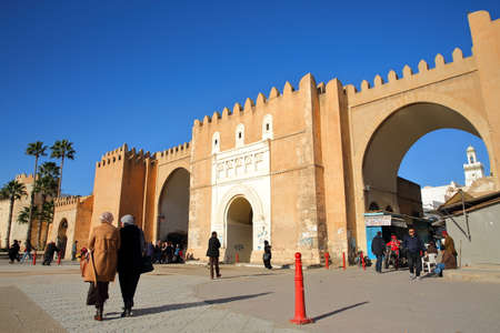 SFAX, TUNISIA - DECEMBER 24, 2019: Bab Diwan, the main entrance gate to the medina of Sfax, with impressive ramparts