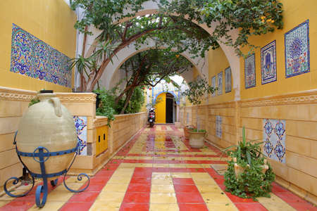 MAHDIA, TUNISIA - DECEMBER 28, 2019: The colorful entrance to the public bath (hammam) inside the medina of Mahdia Editorial