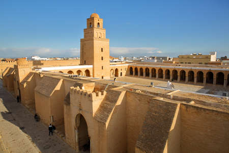 General view of the Great Mosque of Kairouan, Tunisia, viewed from outside, with the minaret and the courtyard