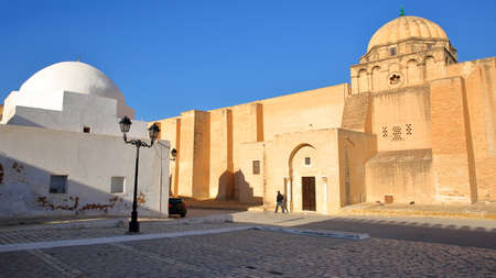 The rear entrance to the prayer room of the Great Mosque in Kairouan, Tunisia, with a whitewashed dome on the left