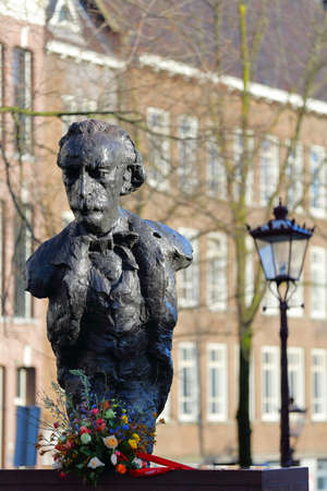 AMSTERDAM, NETHERLANDS - MARCH 03, 2020: Close-up on the statue of Dutch writer Multatuli on the Torensluis bridge along Singel Canal Editorial