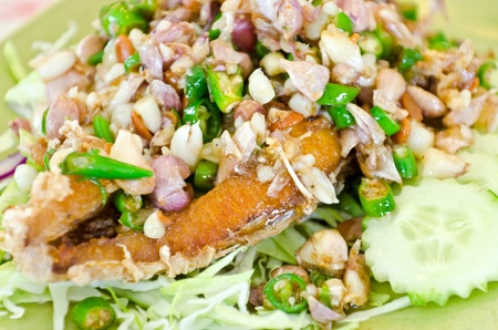 Thai style fish salad in restaurant, Thailand photo
