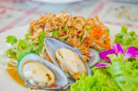 Thai style new zealand sea mussel salad in restaurant, Thailand