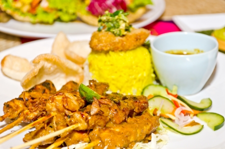 delicious chicken satay on skewers and rice, Tradition Bali Style photo