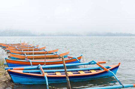 befog: boats and lot of foggy on a lake Stock Photo