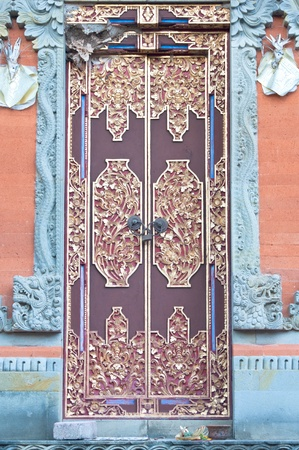 wooden door of country house with carved ornament, Bali Indonesia Stock Photo - 14722802