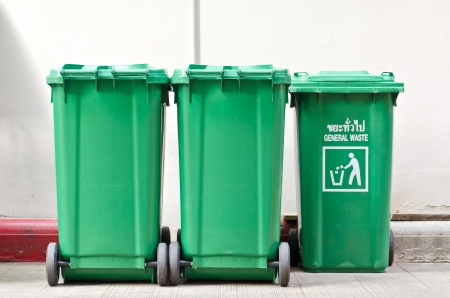 Large green trash cans  garbage bin  with wheels photo