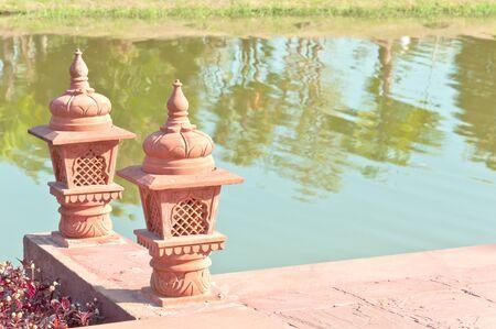 pottery lanterns on brick waterfront photo