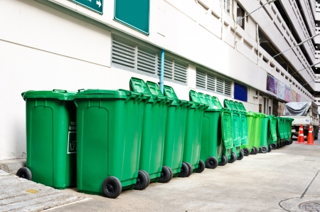 large green trash cans (garbage bin) with wheels Banco de Imagens