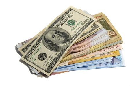big pile of money. dollars ans others on white background photo