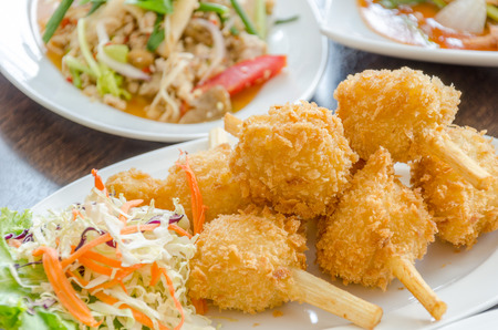 Fried shrimp ball on sugarcane skewers, Vietnamese food  photo