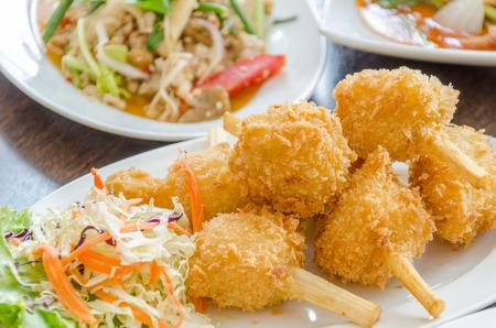 Fried shrimp ball on sugarcane skewers, Vietnamese food  photo