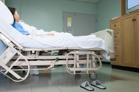 hospital stretcher: Patient on gurney and watching TV in hospital room. Stock Photo