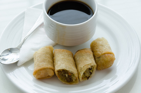 Spring roll or egg roll and cup of coffee  photo