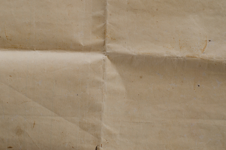 Very old crumpled brown paper texture. photo