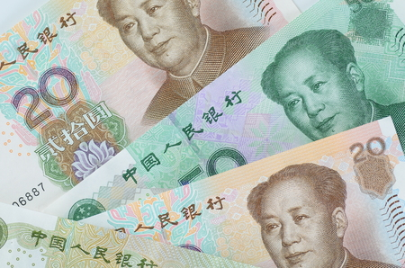 the chairman: Collage of Chinese Rmb banknotes or Yuan with Chairman Mao on the front of each bill