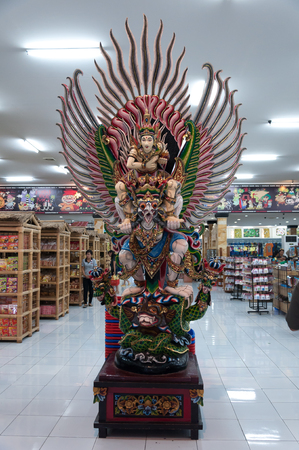 BALI - JUNE 25: The garuda sculpture in front of shopping store on June 25, 2012 in Bali, Indonesia.