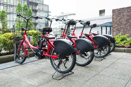 YOKOHAMA - MAY 10: Row of bicycles parking for rent on MAY 10, 2016 in Yokohama, Japan.