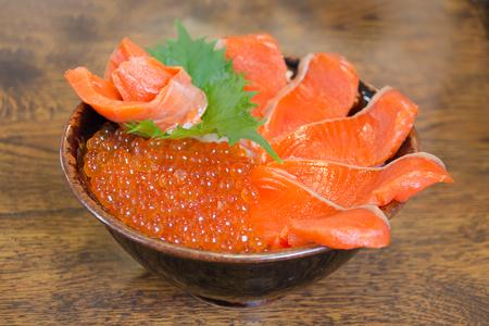 Red caviar and salmon, sashimi raw fish seafood rice bowl -sashimi on rice, donburi, japanese food