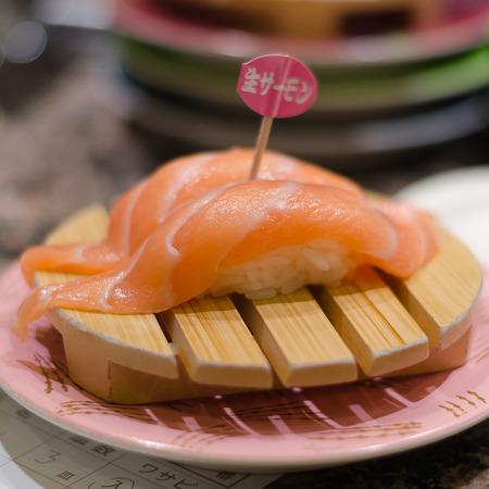 Two Salmon sushi on wood plate Banco de Imagens
