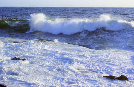 Large wave on the pacific ocean on a rocky shore Stock Photo - 3057381