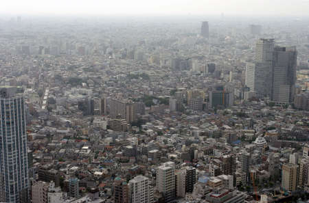 cramped: Aerial view of poluted modern city wrapped in smog