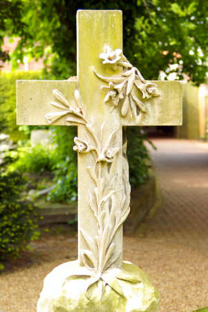 Stone cross with floral motive on a graveyard in Southern England photo